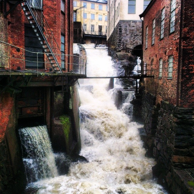 Whitewater running through a brick city.
