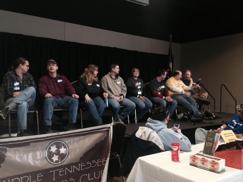 The area reviewers who attended were bold enough to take the stage to answer questions from the audience, as well as to give tips and advice on how best to submit appropriate geocaches. Pictured from left to right are: Doctor Teeth (KY), IronHorseReviewer (KY), Bluegrass Reviewer (KY), Thunder-Chicken (KY), TheScarlettReviewer (IL), Hoosier Reviewer, (IL), NCreviewer (NC) and Dogwood_Reviewer (NC). Serving as emcee and working the crowd was The Seanachai (TN), not pictured.