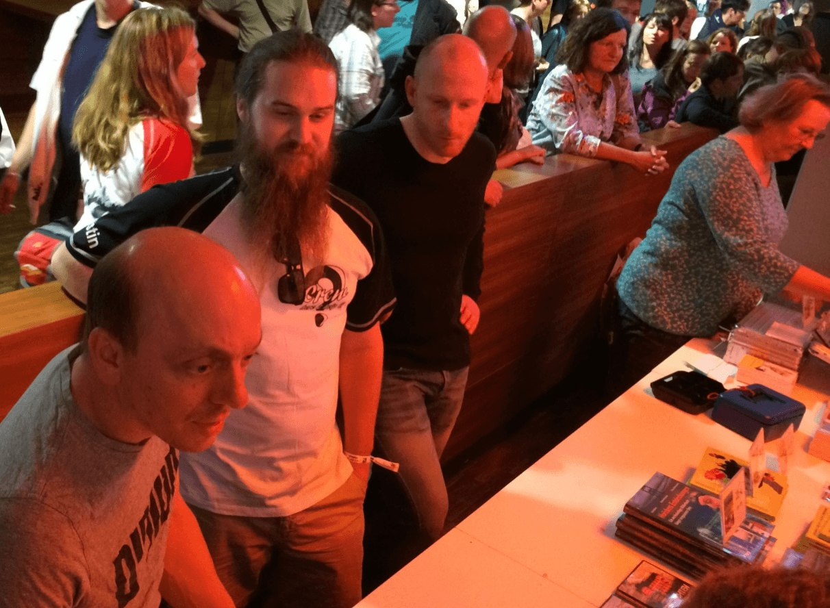 Berhard, Justin and Enno participating in book signing/picture/autograph session