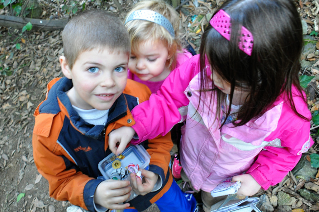This group of kiddos are super excited to find the cache... and its swag.