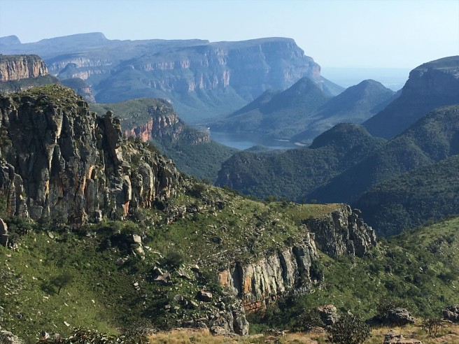 Danie finds GC11H2Z, and a view overlooking the Blyde River Canyon