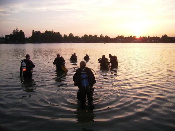 Geocacher Peter_U and friends at a underwater cache site in Finland