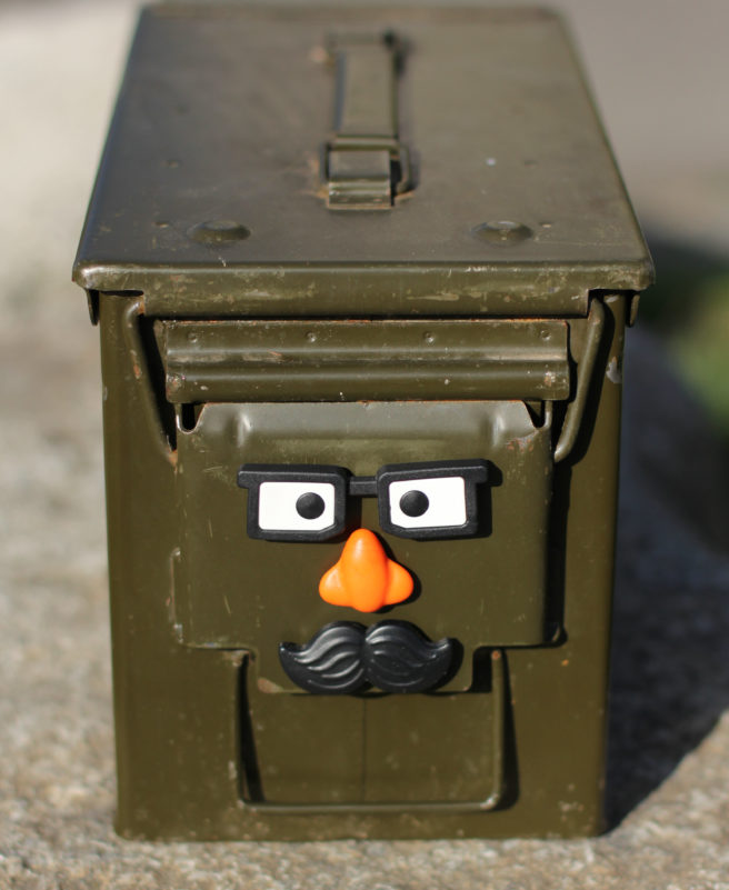 Geocaching ammo can with face