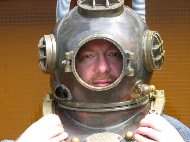 The Cache Owner, Laird McKai, in an old diving helmet.