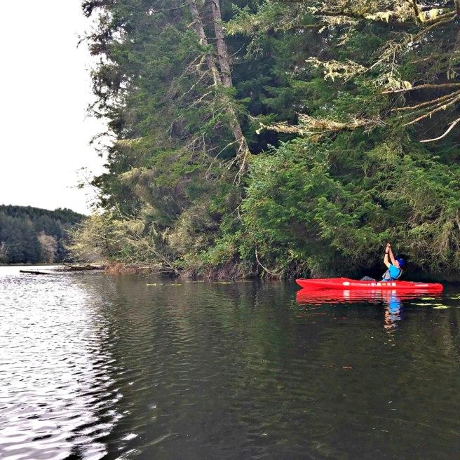Grabbing a remote geocache in a kayak