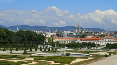 Ornate gardens and a view of the Vienna skyline.